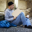 Unemployed homeless beggar is - Stock Photo