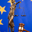 Gavel and the European Union flag - Stock Photo