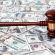 Dollar currency notes and gavel - Stock Photo