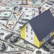 Stock Photo: House on dollar bills