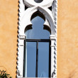 Stock Photo: Stucco decorated window on building in venice