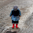 Child has fun with rainwear in rain — Stock Photo #8285051