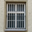 Barred windows of an old prison — Stock Photo