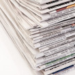 Stacks of old newspapers and magazines - Foto Stock