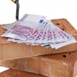 Stock Photo: Construction, financing, building society. brick and €