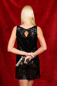 Woman in evening dress with concealed weapon — Stok fotoğraf