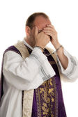 Abuse in the church. priest with handcuffs — Stock Photo
