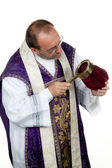 Catholic priest raises money fã ¼ r the church — Stock Photo