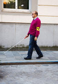 Blind man with stick — Stock Photo