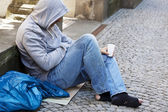 Unemployed homeless beggar is — Stock Photo