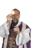 Catholic priest during communion — Stock Photo