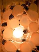 Many bulbs, a lit symbol for ideas — Stock Photo