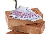 Construction, financing, building society. brick and € — Stock Photo