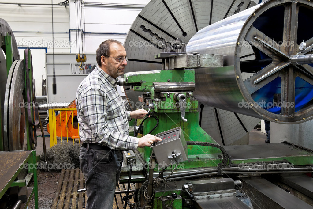 An older workers in the metal industry in cnc milling machine.  Stock Photo #8282687