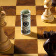 Stock Photo: Chess with dollar and euro bill. abwe u.s. dollars