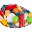 Tablets and medicines on spoon — Stock Photo #8291111