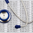 Balance sheet figures and stethoscope — Stock Photo #8292111