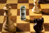 Chess with dollar and euro bill. abwe u.s. dollars — Stock Photo