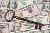 Dollar currency notes and keys — Stock Photo