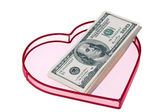 Billets de dollars us dans un coeur — Photo