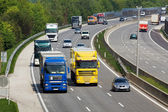 Highway with cars and trucks — Foto Stock
