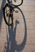 Bike and shadow — Stock Photo