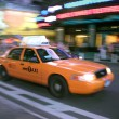 Taxi in Motion - Stock Photo