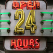 Neon sign displaying open 24 hours — Stock Photo #8315353