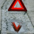 Warning triangle on snow serface - Stock Photo