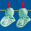 Baby socks on clothesline to dry - Stock Photo