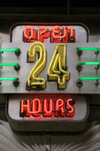 Neon sign displaying open 24 hours — Stok fotoğraf