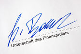 Signature on a document of a tax auditor — Stock Photo