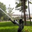 Stock Photo: Lawn watering in a park