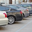Parked cars in a parking lot — Stock Photo