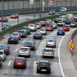 Traffic jam in the road with cars on a highway — Stock Photo #8329196