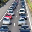 Traffic jam in the road with cars on a highway — Stock Photo #8329560