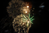 Fireworks on new year's eve and new year — Stock Photo