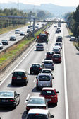 Traffic jam in the road with cars on a highway — Stock Photo