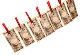 Money laundering and japanese yen on clothesline — Stock Photo