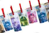 Money laundering with swiss francs on clothesline — Stock Photo