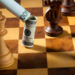 Chess with dollar and euro bill. dollar depreciati - Stock Photo