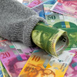 Nest egg with swiss franc banknotes — Stock Photo