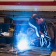 Stock Photo: Welders in workshop in metal industry