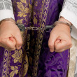 Stock Photo: Abuse in church. priest with handcuffs