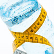 Mineral water with measuring tape. symbol for diet - Stock Photo