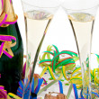 Stock Photo: Champagne bottle and glasses in celebration of the