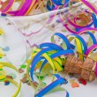 Empty champagne glass and garlands in the carnival — Stock Photo