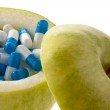 Apple tablets with capsules. symbol for vitamin ta — Stock Photo
