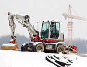 Construction site in winter. saisionale unemployme — Stock Photo
