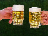 Two pitchers of beer with us beer foam — Stock Photo